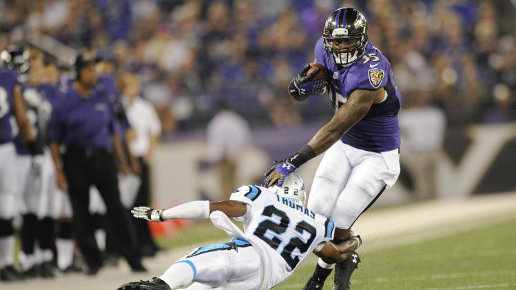 Baltimore Ravens running back Anthony Allen is stopped by Carolina Panthers cornerback Josh Thomas during the second half of a preseason NFL football game in Baltimore, Thursday, Aug. 22, 2013. (AP Photo/Nick Wass)