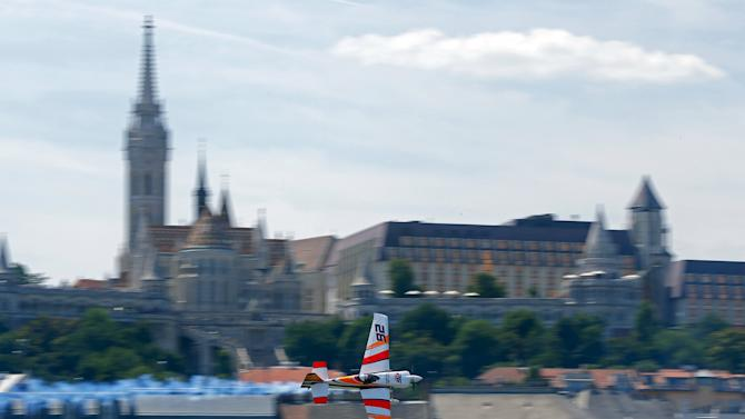 Spanish pilot Juan Velarde flies with his Edge 540 V3 during the qualifying session of the Red Bull Air Race World Championship in Budapest