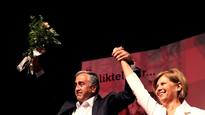 Mustafa Akinci and his wife Meral Akinci celebrate their election victory in Nicosia