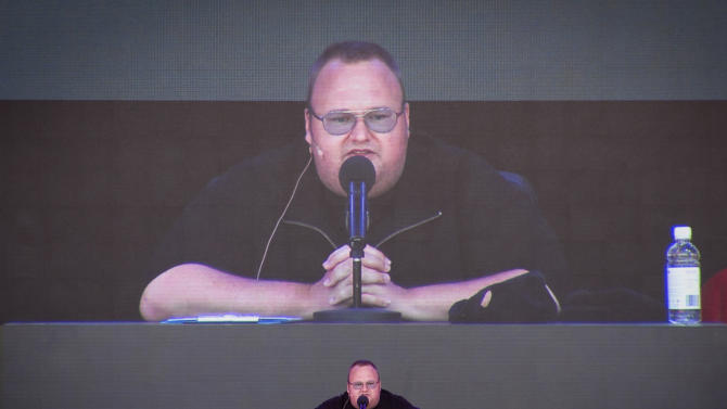 "Indicted Megaupload founder Kim Dotcom practices a speech before the launch of a new file-sharing website called ""Mega"" at his Coatesville mansion in Auckland, New Zealand, Sunday, Jan. 20, 2013. The colorful entrepreneur unveiled the site ahead of a lavish gala and press conference on the one-year anniversary of his arrest on racketeering charges related to his now-shuttered Megaupload file-sharing site. (AP Photo/New Zealand Herald, Richard Robinson) NEW ZEALAND OUT, AUSTRALIA OUT"