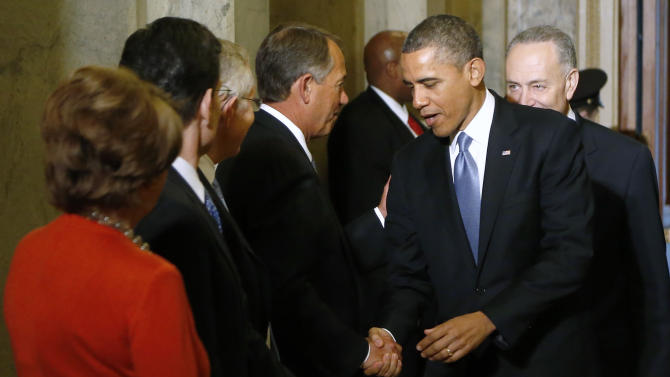 President Barack Obama greets House Speaker John Boehner of Ohio, on Capitol Hill in Washington, Monday, Jan. 21, 2013, for his ceremonial swearing-in during the 57th Presidential Inauguration. (AP Photo/Jonathan Ernst, Pool)