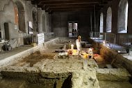 Archaeologists work on the excavation of a grave inside the medieval Convent of Saint Ursula in Florence on July 17. Archaeologists on Tuesday unearthed a skeleton in a rare state of preservation in Florence in a crucial step towards unravelling the mystery of the identity of the woman with the most enigmatic smile in the world -- the Mona Lisa