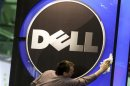 File photo of a man wiping logo of Dell IT firm at CeBIT exhibition centre in Hannover