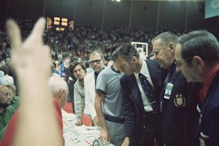USA coach Hank Iba upset during dispute after officials gave USSR three tries to win Gold Medal Game at Rudi-Sedlmayer-Halle. Soviet Union won on controversial calls.