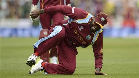 West Indies' Gayle picks himself up during the ICC Champions Trophy match in London