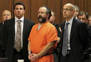 Ariel Castro, 53, stands between attorneys Craig Weintraub and Jaye Schlachet as his sentence is read to him by judge Michael J. Russo in the courtroom in Cleveland