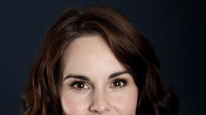 """Actress Michelle Dockery, from """"Downton Abbey"""", poses for a portrait during the PBS TCA Press Tour on Saturday, July 21, 2012, in Beverly Hills, Calif. (Photo by Matt Sayles/Invision/AP)"""
