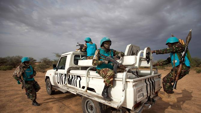 A handout picture taken on July 1, 2014 and released by the United Nations-African Union Mission in Darfur on July 2, 2014 shows UNAMID troops deployed in Khor Abeche, South Darfur