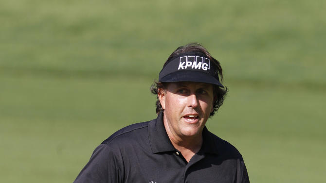 Phil Mickelson from USA celebrates after scoring a birdie at the 10th hole during the first round of the WGC-HSBC Champions golf tournament in Dongguan, southern China's Guangdong province, Thursday Nov. 1, 2012. (AP Photo/Kin Cheung)