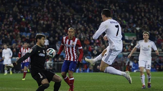 Real's Cristiano Ronaldo tries to score as he faces Atletico goalkeeper Daniel Aranzubia during a semi final, 2nd leg, Copa del Rey soccer derby match between Real Madrid and Atletico Madrid at the Vicente Calderon Stadium in Madrid, Tuesday Feb. 11 , 2014