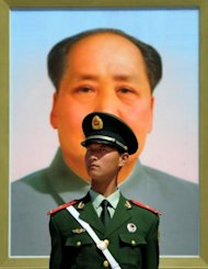 A Chinese policeman stands in front of a portrait of the late Chinese leader Mao Zedong at Baijing's Tiananmen Square in April 2012. The wife of Bo Xilai -- the former political leader whose downfall sent shockwaves through China -- has been charged with murdering a British businessman, according to the Xinhua news agency
