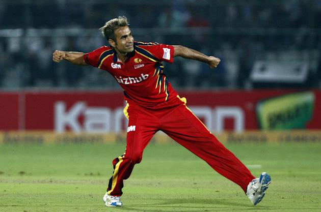 Imran Tahir celebrates after fall of a wicket during the Champions League T20 match between Lions and Otago Volts at Sawai Mansingh Stadium, Jaipur on Sept. 29, 2013. (Photo: IANS)