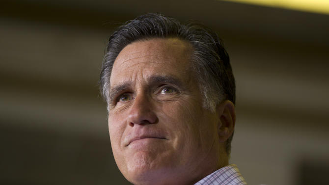 Republican presidential candidate, former Massachusetts Gov. Mitt Romney pauses during a campaign event at Horizontal Wireline Services on Tuesday, July 17, 2012 in Irwin, Pa.  (AP Photo/Evan Vucci)