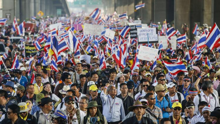 Protest leader Suthep marches with anti-government protesters during a rally in Bangkok