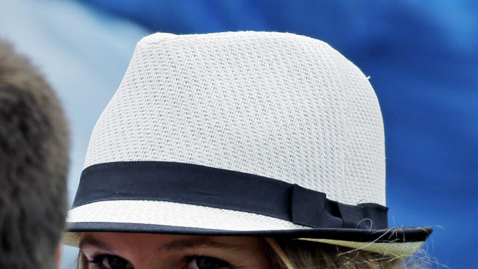 Tennis player Caroline Wozniacki speaks with a spectator while watching Rory McIlroy, of Northern Ireland, during the first round of the Masters golf tournament Thursday, April 11, 2013, in Augusta, Ga. (AP Photo/David J. Phillip)