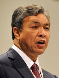 Malaysian Defence Minister Ahmad Zahid Hamidi speaks during the Asia-Pacific security forum in Singapore in 2010. A scandal linking Malaysia&#39;s leader, a young woman&#39;s murder and alleged kickbacks in a French submarine deal has resurfaced as a potential danger for the government as elections loom