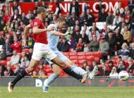 Manchester City's Dzeko scores his second goal against Manchester United during their English Premier League soccer match in Manchester