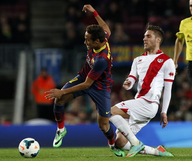 Barcelona's Neymar vies the ball against Rayo Vallecano's Rochina during their Spanish first division soccer match in Barcelona