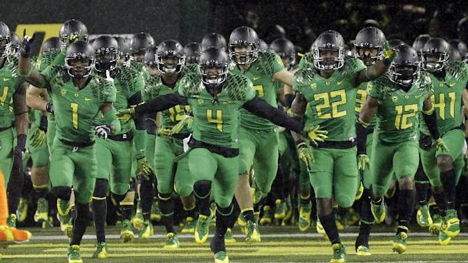 The Oregon football team takes the field at Autzen Stadium before an NCAA college football game against California in Eugene, Ore., Saturday, Sept. 28, 2013.  Oregon won 55-16