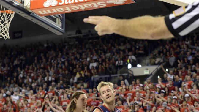 Saint Mary's Mitchell Young (3) is disapointed by a call as Gonzaga's Kelly Olynyk (13) watches, in the first half of an NCAA college basketball game, Thursday, Jan. 10, 2013, in Spokane, Wash. (AP Photo/Jed Conklin)