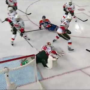 Reto Berra stops a flurry of Oilers shots