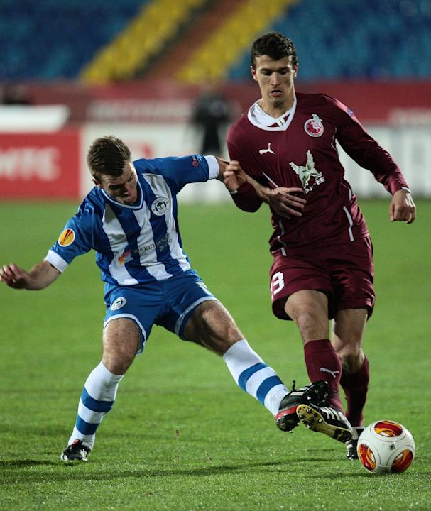 Rubin Kazan's Roman Eremenko, right, fights for a ball with Wigan Athletic's Callum McManaman during their Europa League  group D soccer match in Kazan, Russia, Thursday Nov. 7, 2013