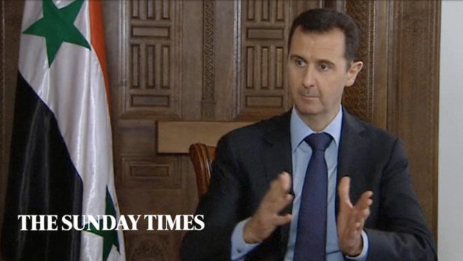 "In this image taken from video filmed on Thursday, Feb. 28, 2013 and released Saturday evening, March 2, 2013, Syrian President Bashar Assad gestures while speaking during an interview with the Sunday Times, in Damascus, Syria. Iran and Syria condemned a U.S. plan to assist rebels fighting to topple Assad on Saturday and signaled the Syrian leader intends to stay in power at least until 2014 presidential elections. Assad told the Sunday Times in the interview timed to coincide with U.S. Secretary of State John Kerry's first foreign trip that ""the intelligence, communication and financial assistance being provided is very lethal."" Kerry announced on Thursday that the Obama administration was giving an additional $60 million in assistance to Syria's political opposition and would, for the first time, provide non-lethal aid directly to the rebels.  (AP Photo/Sunday Times via AP video) THIS IMAGE IS FOR USE FOR 24 HOUR NEWS ACCESS ONLY, SUNDAY TIMES LOGO MUST NOT BE OBSCURED, NO ARCHIVES, NO SALES /PLEASE CONTACT SUNDAY TIMES SYNDICATION DEPARTMENT BY EMAIL TO ENQUIRIES@NISYNDICATION.COM FOR QUESTIONS REGARDING USE OUTSIDE THE 24 HOUR NEWS ACCESS WINDOW"