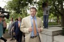 Former baseball star Roger Clemens walks outside Federal District Court in Washington