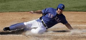Lance Berkman singles, scores twice in Texas debut