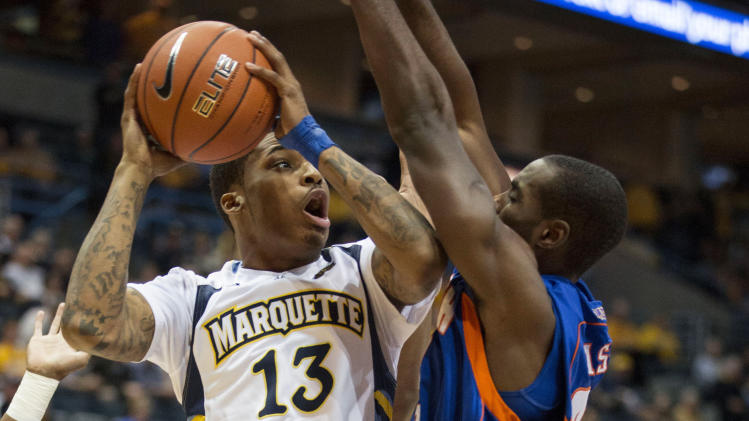 Marquette's Vander Blue drives on Savannah State's Angelo Davis during the first half of an NCAA college basketball game, Saturday, Dec. 15, 2012, in Milwaukee. (AP Photo/Tom Lynn)
