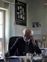 "Omarkhan Massoudi, Director of the National Museum of Afghanistan, at his office in Kabul. ""I'm happy we preserved some masterpieces through a difficult time in our country,"" Massoudi told AFP, recounting how a decision was made to move major works to secret locations in 1989 as Soviet forces withdrew and civil war loomed"