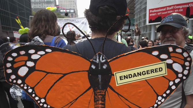 "A protester carries a sign during the ""People's Climate March"" in the Manhattan borough of New York"
