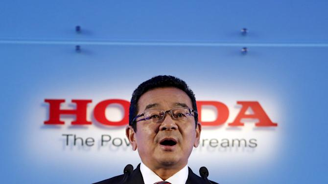 Honda Motor Co's new President and Chief Executive Officer Hachigo speaks during a news conference at the company's headquarters in Tokyo