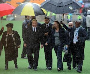 Raul Castro (uncer umbrella) arrives for Nelson Mandela's …