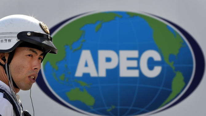 A Japanese police officer stands guard near the APEC venue in Yokohama near Tokyo, Japan, Tuesday, Nov. 2, 2010. The Asia-Pacific Economic Cooperation forum holds leaders' summit in Yokohama on Nov. 13 and 14. (AP Photo/Itsuo Inouye)