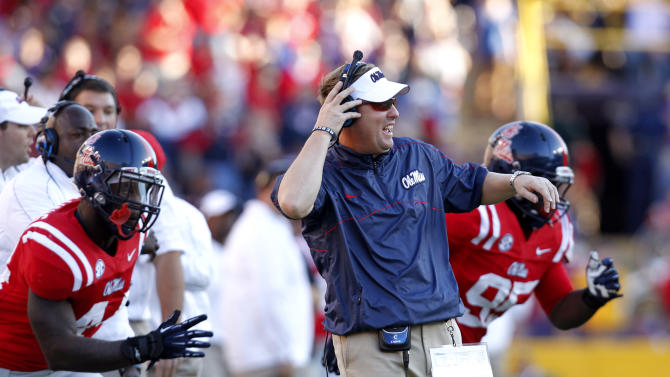 Mississippi head coach Hugh Freeze reacts to an official's call in the first half of their NCAA college football game against LSU in Baton Rouge, La., Saturday, Nov. 17, 2012. (AP Photo/Gerald Herbert)