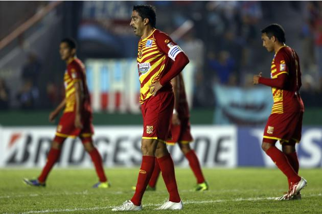 Cichero of Venezuela's Deportivo Anzoategui and his teammates react after receiving a second goal during their Copa Libertadores soccer match against Argentina's Arsenal in Buenos Aires