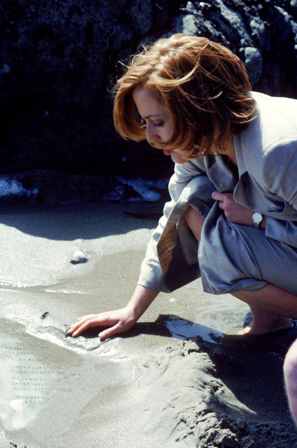 "This publicity photo courtesy of Twentieth Century Fox Television shows Gillian Anderson, as Special Agent Dana Scully, in a scene from the TV series, ""The X-Files."" (AP Photo/Copyright Twentieth Century Fox Film Corporation)"