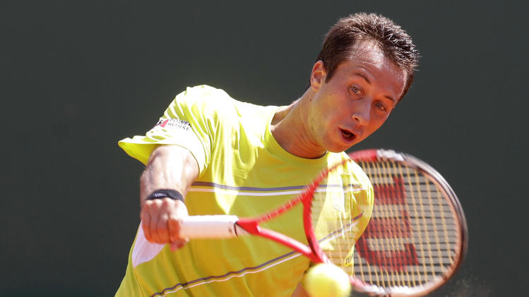 Philipp Kohlschreiber of Germany plays a return during his match against Spain's Rafael Nadal at the Monte Carlo Tennis Masters tournament in Monaco, Thursday, April 18, 2013. (AP Photo/Lionel Cironneau)