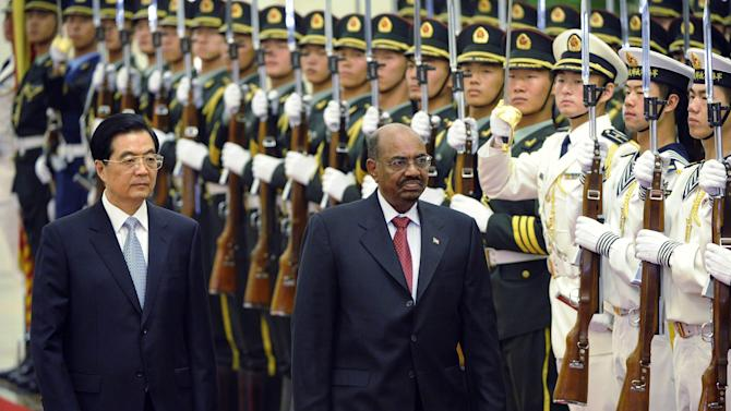 Sudan's President Omar al-Bashir, right, and Chinese President Hu Jintao review the Chinese military honor guard during a welcoming ceremony at the Great Hall of the People in Beijing, China Wednesday, June 29, 2011. (AP Photo/Liu Jin, Pool)