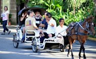 Tourists ride on a horse driven carriage in Intramuros in downtown Manila in 2010. Philippine tourism promotion efforts suffered another blow Friday over claims its new slogan copied an old Swiss one, having already ditched an earlier campaign that allegedly plagiarised Poland's