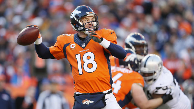 Denver Broncos quarterback Peyton Manning (18) throws against the Oakland Raiders during the first half of an NFL football game, Sunday, Dec. 28, 2014, in Denver. (AP Photo/Joe Mahoney)