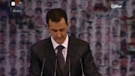 "President Bashar al-Assad offers a road map to end Syria's civil war in a rare speech in which he brands the opposition ""slaves"" of the West and tells foreign powers to end their support for the rebels. Duration: 01:39"