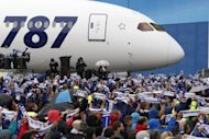 Boeing employees hold their scarves up as All Nippon Airways (ANA) receive their first 787 during a delivery ceremony in 2011, in Everett, Washington. ANA said Friday it would order 11 more Boeing 787 Dreamliners, with a list price of around $2.68 billion