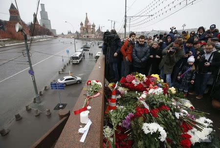 People visit the site where Boris Nemtsov was shot dead near the Kremlin and Red Square in central Moscow