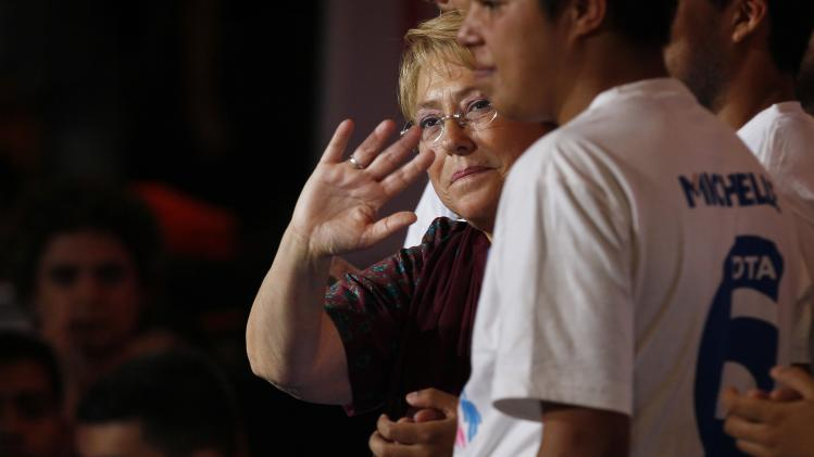 In this Dec. 12 photo, Presidential candidate Michelle Bachelet waves during a closing campaign rally in Santiago, Chile. Bachelet is almost certain to win Sunday's presidential runoff and return to power on a promise to reduce Chile's huge gap between the rich and poor. (AP Photo/ Luis Hidalgo)
