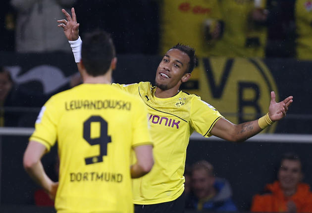 Dortmund's Robert Lewandowski of Poland, left, and Dortmund's Pierre-Emerick Aubameyang of Gabon celebrate after a goal was scored,  during the German first division Bundesliga soccer match between  B