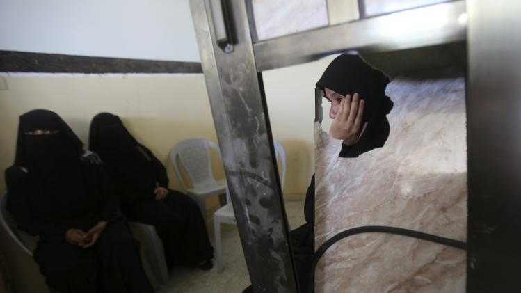 A Palestinian relative of Islamic Jihad militant Hammad reacts during his funeral in Rafah