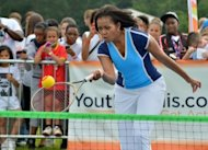 "US First Lady Michelle Obama plays tennis during the ""Let's Move-London"" event in London on July 27. With charm, hidden steel and growing political skill, First Lady Michelle Obama is injecting a timely jolt of verve into her husband's battered political brand"