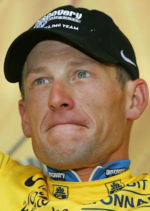 FILE - In this July 6, 2005 file photo, overall leader Lance Armstrong reacts on the podium after the fifth stage of the Tour de France cycling race between Chambord, western France, and Montargis, south of Paris. Armstrong is still fighting a Texas company that wants to recoup about $12 million in bonuses he was paid for winning the Tour de France while secretly using performance-enhancing drugs. (AP Photo/Christophe Ena, File)